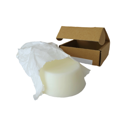 small circular vegan solid conditioner bar next to a brown cardboard box palm oil free australian made hand made plastic free recyclable packaging